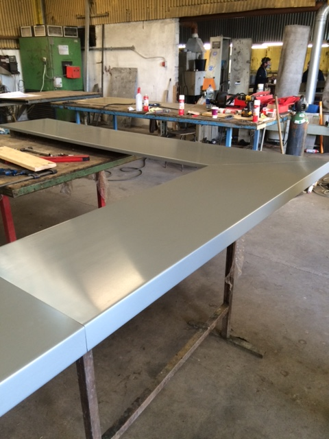 Zinc counter top being fabricated