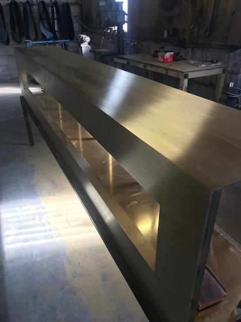 Welded and polished corners to the brass columns