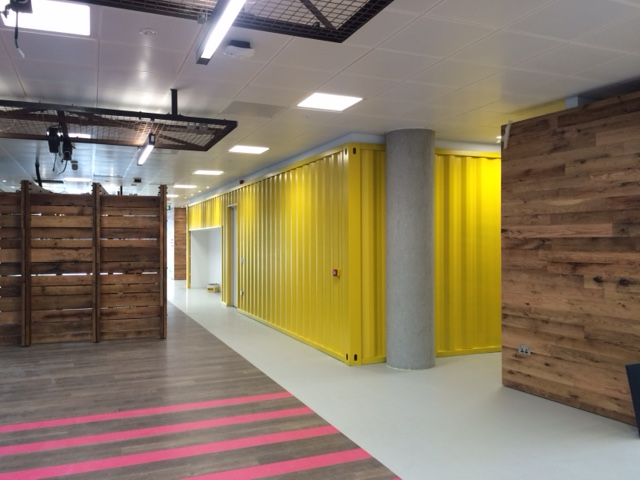 Vibrant colours applied on site to shipping containers